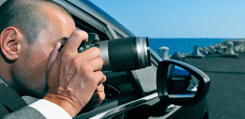 Surveillance Services in Brazil - a detective or a paparazzi taking photos from inside a car